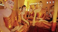 Room full with statues of buddha. burma, yangon Stock Footage