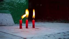 Three candles in buddhist temple, burma, yangon Stock Footage