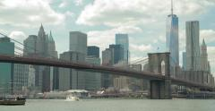 New York City Brooklyn Bridge pan across buildings skyline 4k - stock footage