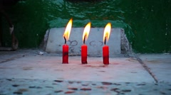 Candles in the old buddhist monastery in myanmar, yangon Stock Footage