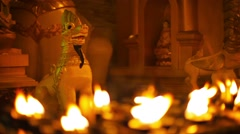 Statues of mythical monsters in a buddhist temple at night. ritual lighting w Stock Footage
