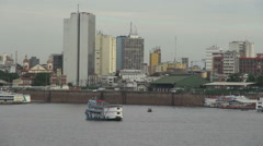 Manaus Amazon River at downtown skyline 1s Stock Footage