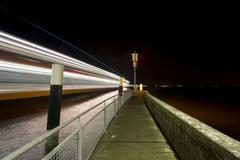 ferry port in konstanz staad light traces of a moving ferry, lake constance,  - stock photo
