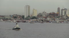 Manaus Amazon River with tug boats and skyline Stock Footage