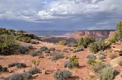 approaching thunderstorm clouds on the eastern edge of the green river canyon - stock photo