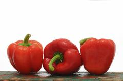 Three red capsicums Stock Photos