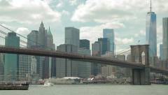 New York City Brooklyn Bridge pan across buildings skyline - stock footage