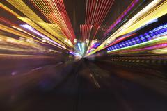 bumper cars, zoomed, at night - stock photo