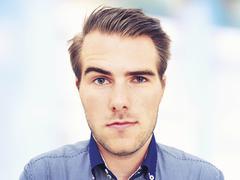 Young man, portrait, sceptical face Stock Photos
