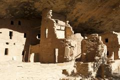 abandoned settlement of the anasazi indians under rocks, with walls and ruins - stock photo