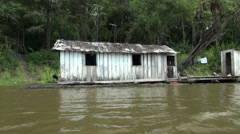 Amazon January Lake house with outhouse Stock Footage