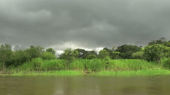 Amazon Brazil lowering cloud over lake  Stock Footage