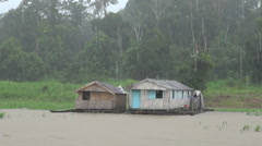 Amazon Brazil rain on floating houses in lake Stock Footage