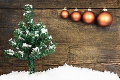 Card with christmas balls, a fir tree and snow Stock Photos