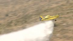 Yellow fire fighter, agriculture aircraft , crop duster  put the fire out Stock Footage