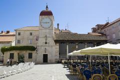 Loggia and the city hall bell tower, trogir, northern dalmatia, croatia, euro Stock Photos