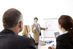 business meeting with a flipchart - stock photo