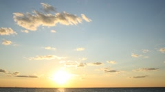 Time Lapse Sunset Under Moving Clouds [HDTV] 16x9 Stock Footage
