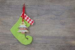 Green santa boots on a shabby wooden background for a christmas card Kuvituskuvat