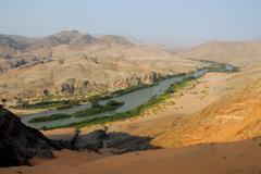 overlooking the kunene river at the namibian-angolan border, kaokoveld, namib - stock photo
