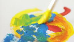 Painting and mixing colors on the peace of paper, art therapy, expression Stock Footage