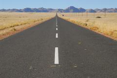 Lonely road near aus, namibia, africa Stock Photos