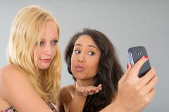 girlfriends taking selfie while kissing - stock photo