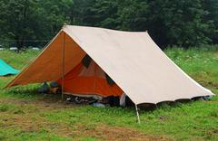 camping tent in a scout camp on the lawn - stock photo