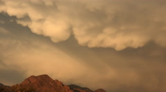 4K Big Puffy Mammatus Clouds Sweep Across Sky At Sunset Time Lapse Stock Footage