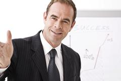 manager standing in front of a flipchart - stock photo