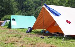 drying laundry to dry near the camping tents in a scout camp - stock photo