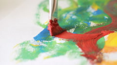Painting with gouache on the peace of paper, art, culture, camera movement - stock footage
