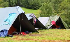 tents in a scout camp and drying laundry out to dry - stock photo