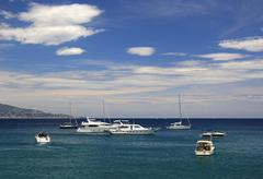 sailing yachts and motor-boats off the côte d\'azur coast, south of france,  - stock photo