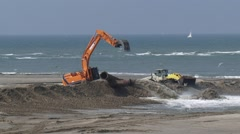 Dredging pipe pumps sand ashore, a slurry mixture of sand and water - stock footage