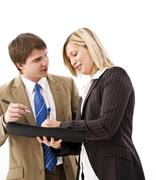 Young manager and secretary checking dates in the appointment calendar Stock Photos