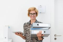 Busy efficient young woman in the office Stock Photos