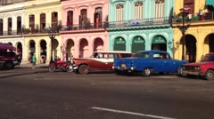 Stock Video Footage of Classic cars and colourful houses downtown Havana, Cuba