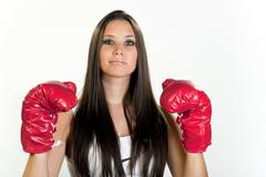Young woman, 20, wearing boxing gloves and looking proud Kuvituskuvat