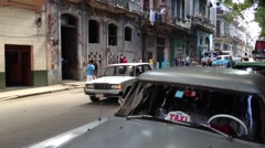 Classic blue car driving through in Havana, Cuba Stock Footage