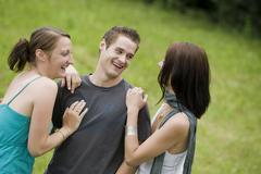 three young people, 20+ - stock photo