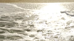 A wave crached into the sand in slow motion Stock Footage