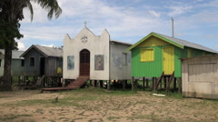 Amazon village church and houses  - stock footage