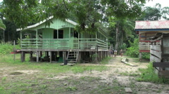 Amazon village house on stilts  Stock Footage
