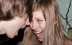 Siblings aged 13 and 15 years trying to argue Stock Photos