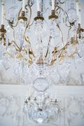 antique crystal  lamp against wall with stucco work - stock photo