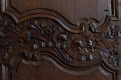 floral embellishment on wooden panel - stock photo