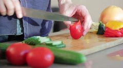 Cutting up a tomato Stock Footage