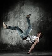 Young b-boy man doing brake dancing movements Stock Photos