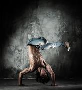 Young b-boy man with naked torso doing brake dancing movements Stock Photos
